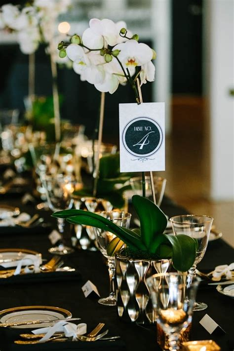 black white  gold tablescape  orchid centerpieces wedding inspiration board junebug
