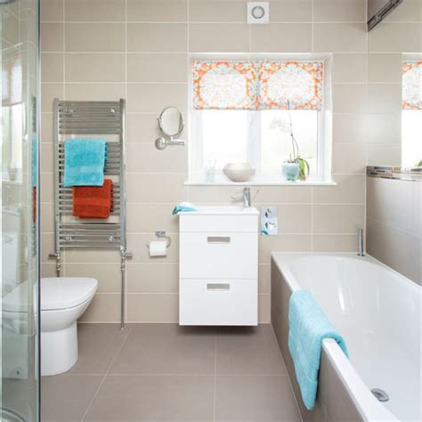 blue and orange bathroom neutral bathroom with orange and blue accents