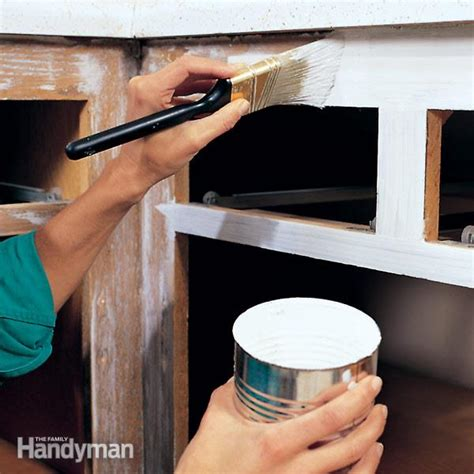 how hard is it to paint kitchen cabinets how to paint kitchen cabinets the family handyman