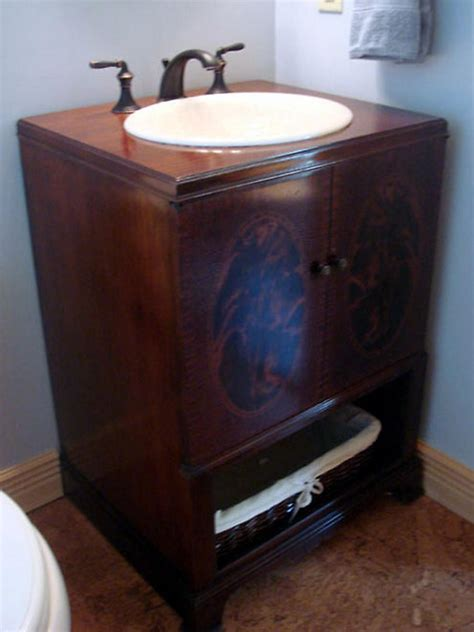 repurposed furniture for bathroom vanity how to repurpose an antique cabinet into a vanity how