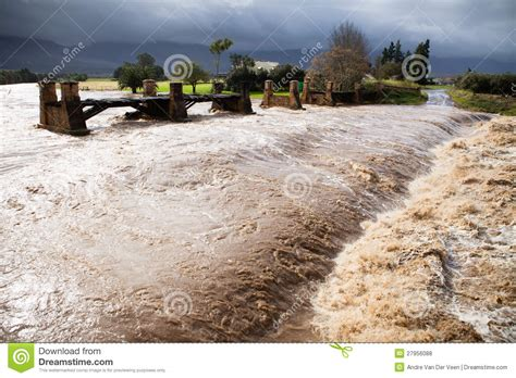 Flood A River S Rage Free Raging Flood Waters Of A River In Flood Stock Photo Image 27956088