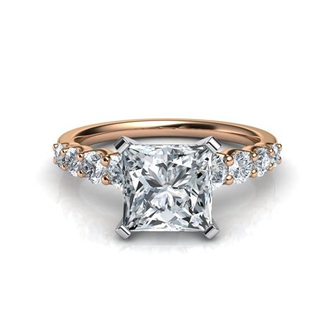 graduated side princess cut engagement ring