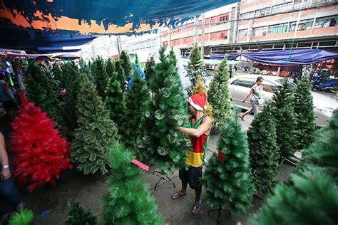 plastic christmas trees await buyers in divisoria gma