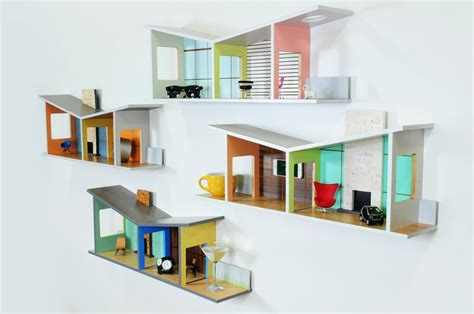 unique and playful shelves in shape of houses floating