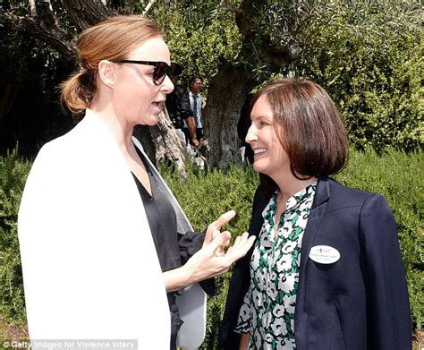 molly isaksen stella mccartney wears black jumpsuit with white blazer at