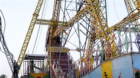 boat swing ride locked on shot of boat swing ride in an amusement park at