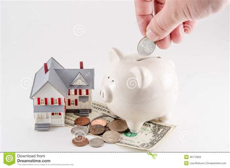 Saving To Build Buy A Home House Piggy Bank With Coin Being Stock Photo Image