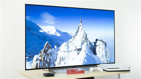 what size tv should i buy for my living room 4k vs 1080p and upscaling is uhd worth the upgrade