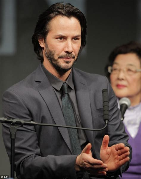 rinko kikuchi real height keanu reeves bows in a slick petrol grey suit as he