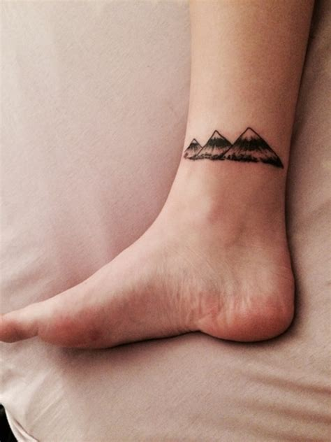 mountain tattoo on foot three mountains on ankle