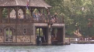 as nick saban and tim tebow jump a boat house