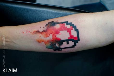 pixel tattoo arist klaim gives a from the mario