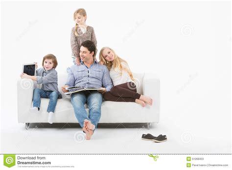family sofa happy family at home stock photo image 51268453