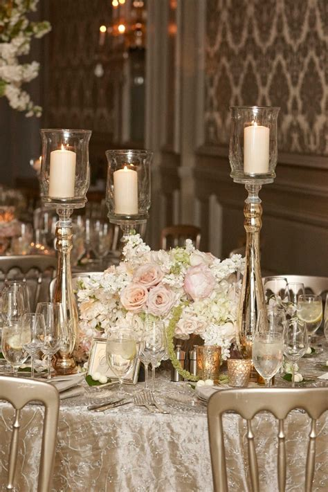 gold and cream pillar candles reception d 233 cor photos pillar candles around white pink arrangement inside weddings