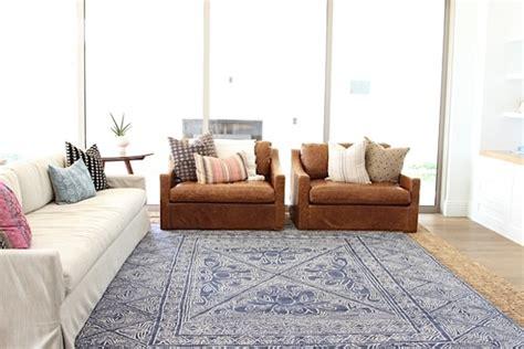 layering area rugs rug trend layering w jute