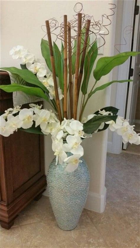 diy large bamboo vases branch arrangements in tall floor vases diy floral arrangement with orchids in a turquoise glass