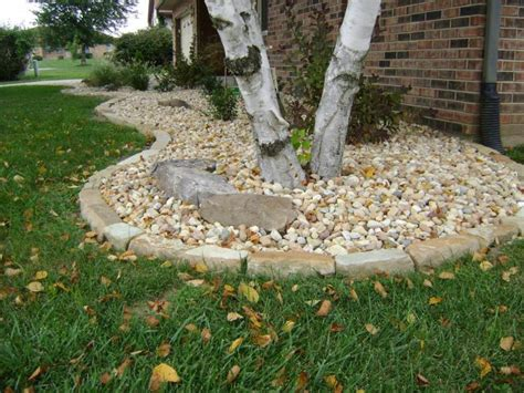 weilbacher landscaping installation of mulch decorative rock trees shrubs berms bed Rocks For Garden Borders