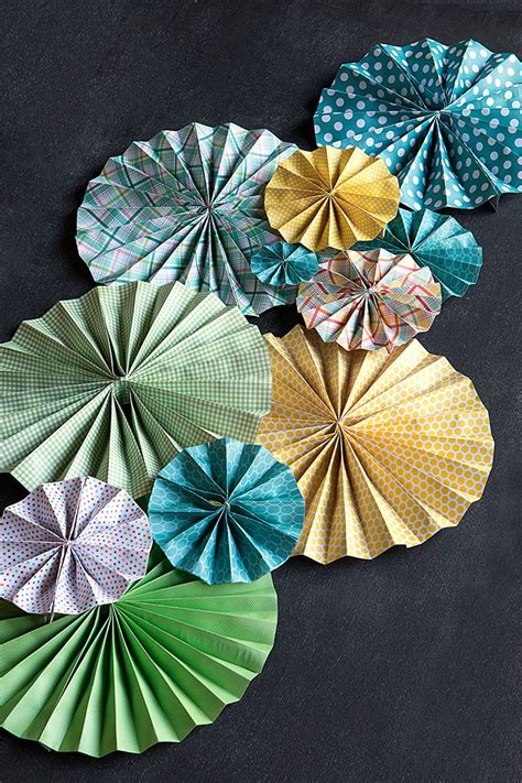 how to hang paper fans on wall diy paper fans wedding inspiration