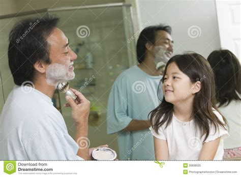 dad daughter in bathroom daughter watching father apply shaving cream in bathroom
