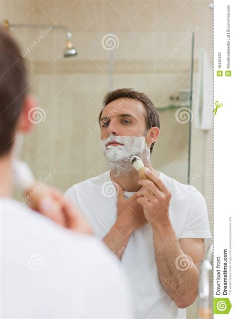 shaving in the bathtub man shaving in the bathroom stock photos image 18440433