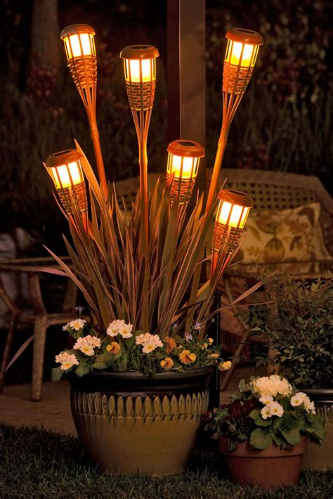 Outdoor Torch Lighting The Land Scape That I On Pinterest Window Well Pergolas And Decks