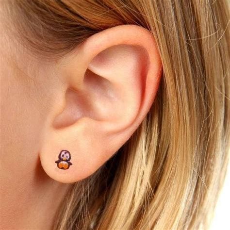 little penguin monkey earring tattoos mimosura