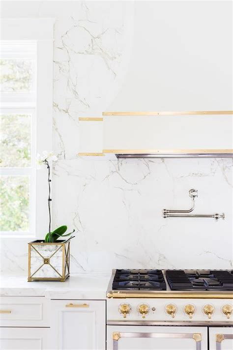 white and gold range white kitchen cabinets gold pulls design ideas
