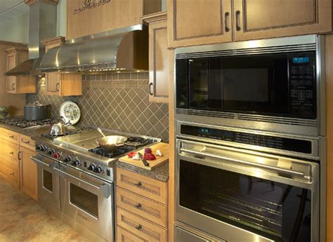 small white kitchen with steel hood stainless steel appliances the best choice