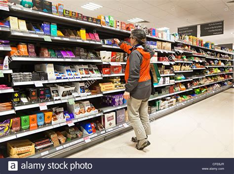 Shelf Shopping by Selecting Chocolate From Choice On Shelves In