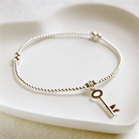 delicate silver bead bracelet with key charm by highland