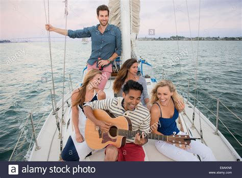 how to play boat drinks on guitar young man playing guitar stock photos young man playing