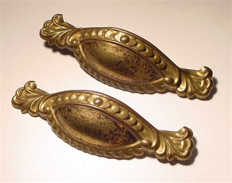 antique drawer pulls vs antique reproduction drawer pulls