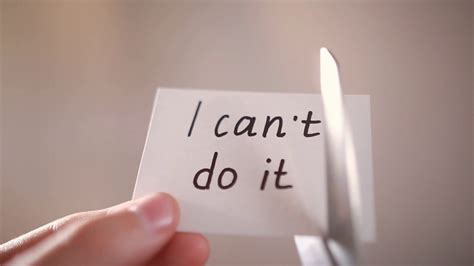 libro i cant do this man using scissors to remove the word can t to read i can do it concept for self belief stock
