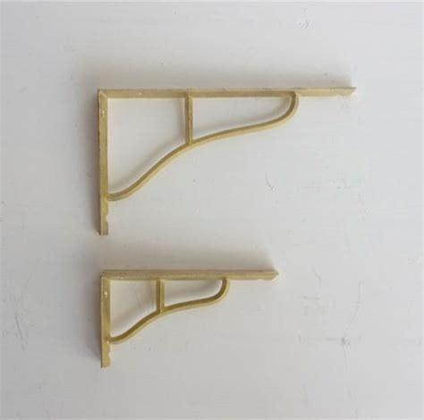 futagami brass shelf supports remodelista