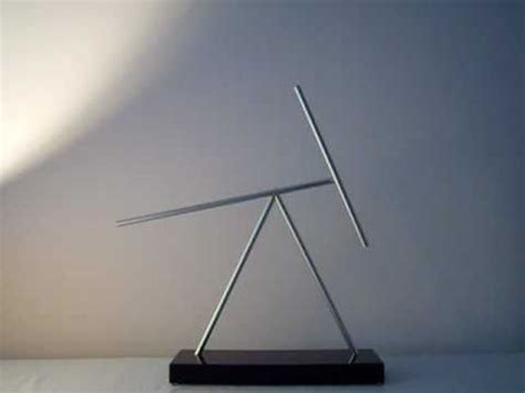 swinging sticks kinetic energy sculpture the swinging sticks big iron man 2 kinetic energy desk
