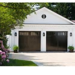 shiny black garage doors inviting exteriors