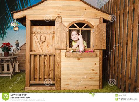 little girl house cute little girl inside wooden house stock photo image 54541202