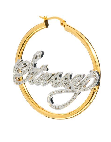 stussy name plate hoop earrings in metallic lyst