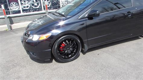 2012 honda civic coupe with 18 inch black rims