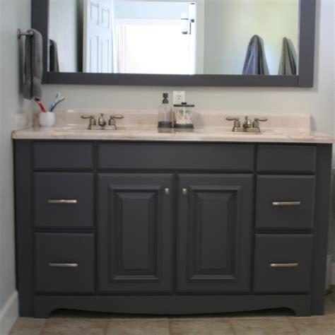 Black wooden bathroom double vanity having white top and sink on ceramics flooring plus