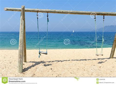 swing in the beach double swing on beach by the sea royalty free stock image