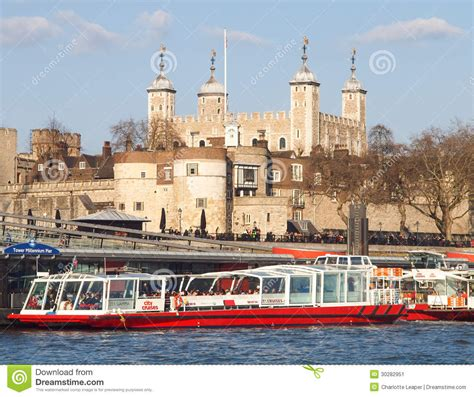 thames river cruise london england tower of london and river cruise boats editorial photo