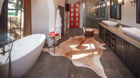 cowhide bathroom rugs 20 lovely ways cowhide and sheepskin rugs adorn a bathroom