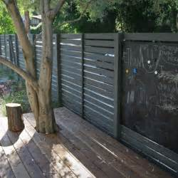 fence fashion 11 ways to add curb appeal with horizontal stripes gardenista