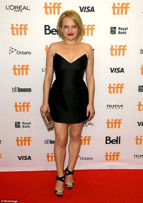 Elisabeth Moss stuns in a mini dress at The Bleeder