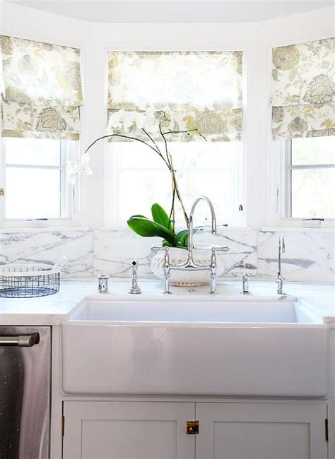 kitchen bay window sink with floral shades