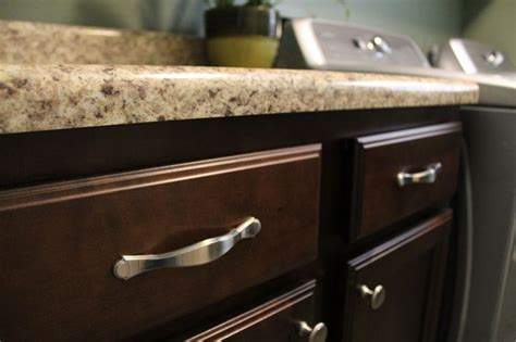handles for kitchen cabinets and drawers handles on cabinet drawers and knobs on cabinet doors silver nickel with dark cabinets