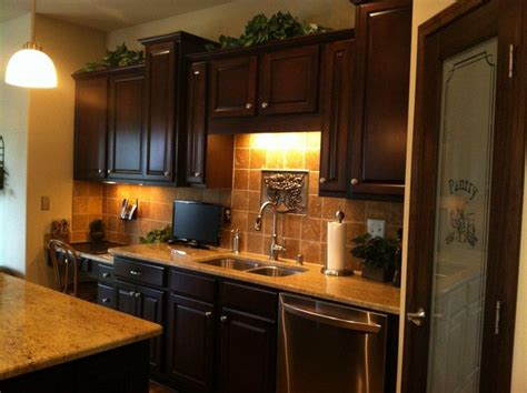kitchen cabinets over sink window no window over your sink use a decorative piece that