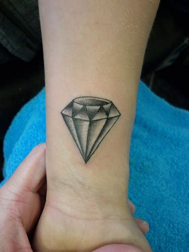 Tattoo Diamond Ink | neck tattoo ideas red wing tattoo