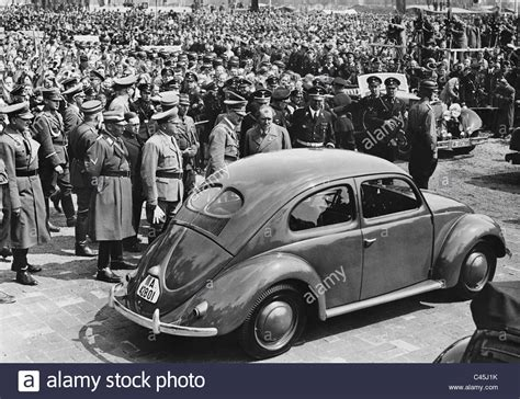 Ferdinand A Porsche by Adolf And Ferdinand Porsche With A Kdf Car 1938